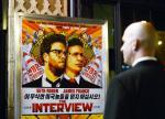 "File photo of a security guard standing at the entrance of United Artists theater during the premiere of the film ""The Interview"" in Los Angeles"